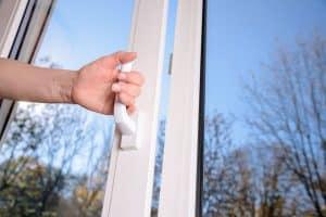 person opening glass door