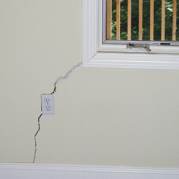 cracked wall in inside of house near window