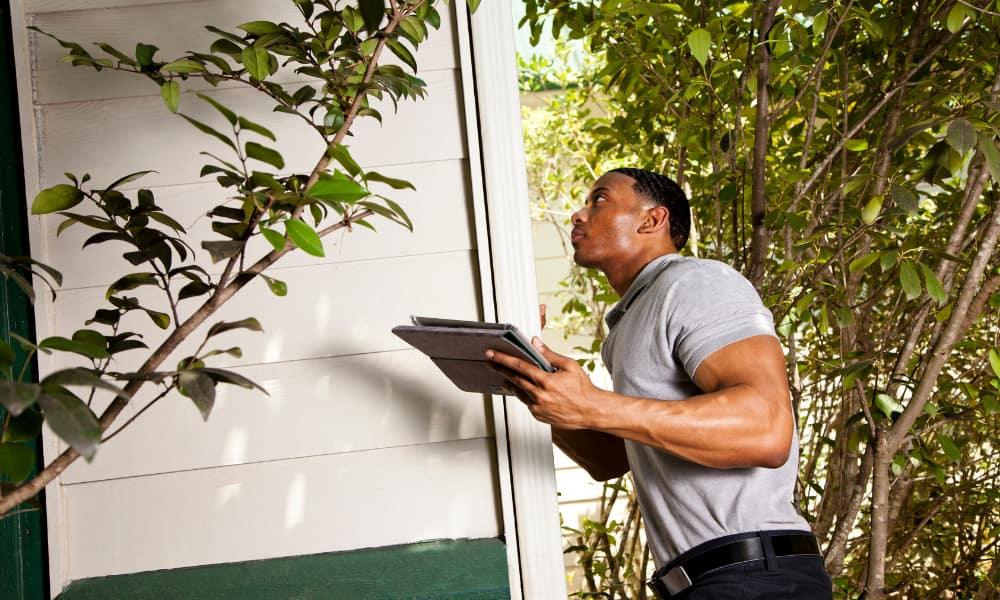 examining home exterior for crawl space damage