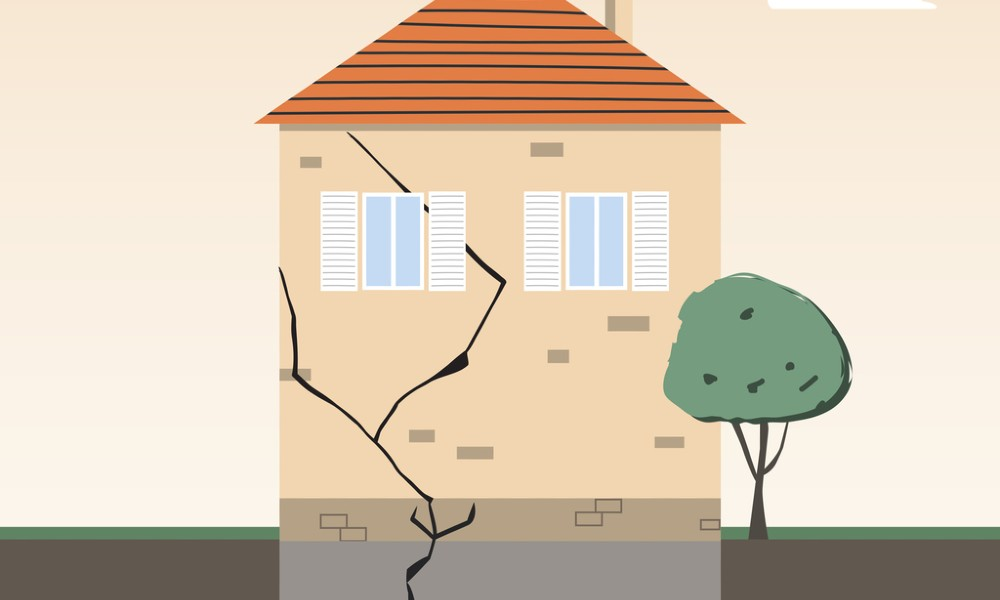 illustration of a house in need of foundation inspection with a crack leading up from the foundation