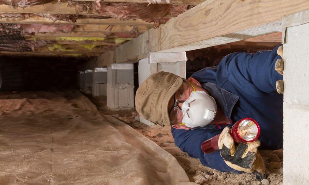 Man sealing a crawl space