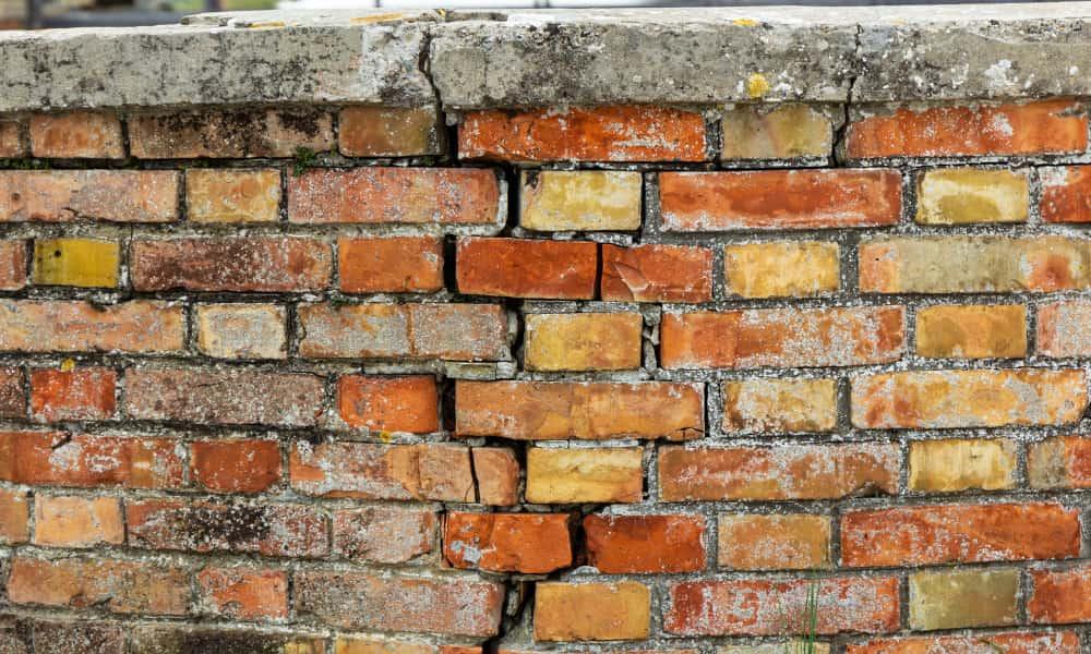 a cracked brick wall that needs mortar repair